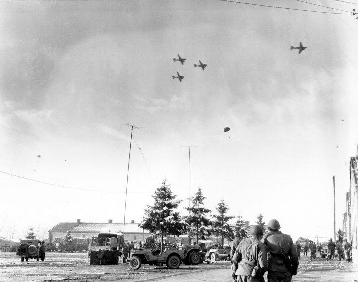 Watching_C-47's_drop_supplies.jpg